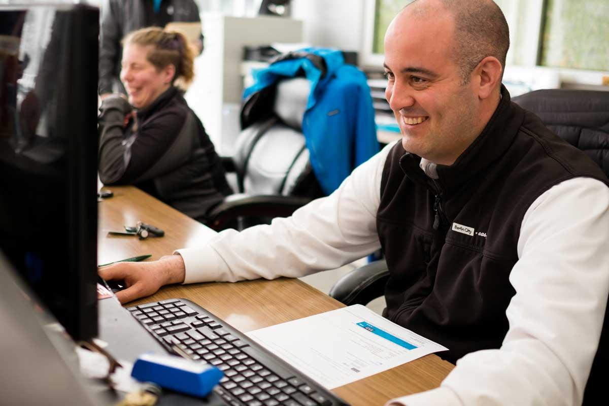 Man smiling while working