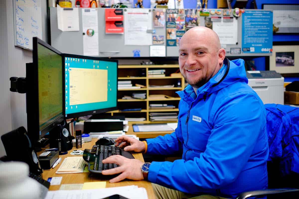 Man smiling at camera while working